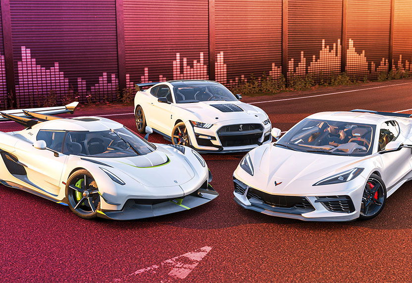 Three white Forza cars ready for livery designs inspired by Hispanic and Latino heritage.