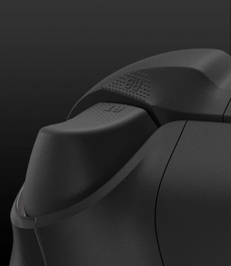 Левый триггер с текстурированной поверхностью на беспроводном геймпаде Xbox из особой серии к 20-летней годовщине
