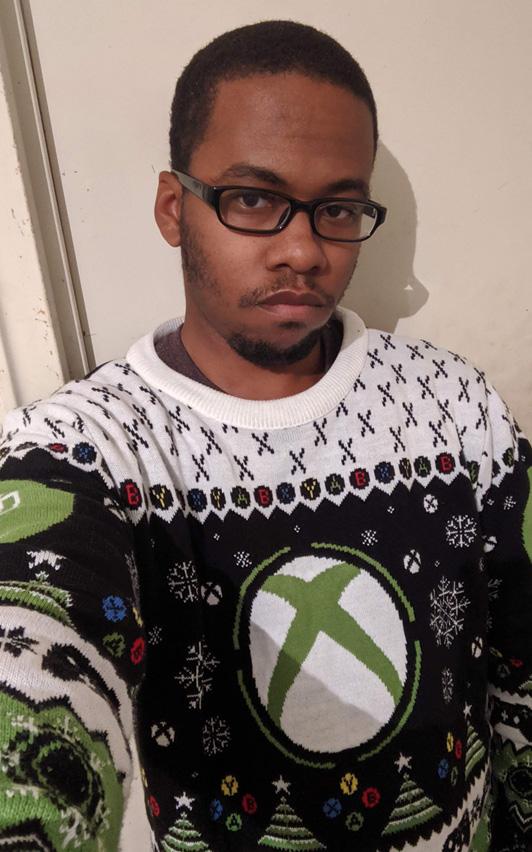 MTA Raylz wearing an Xbox holiday sweater.