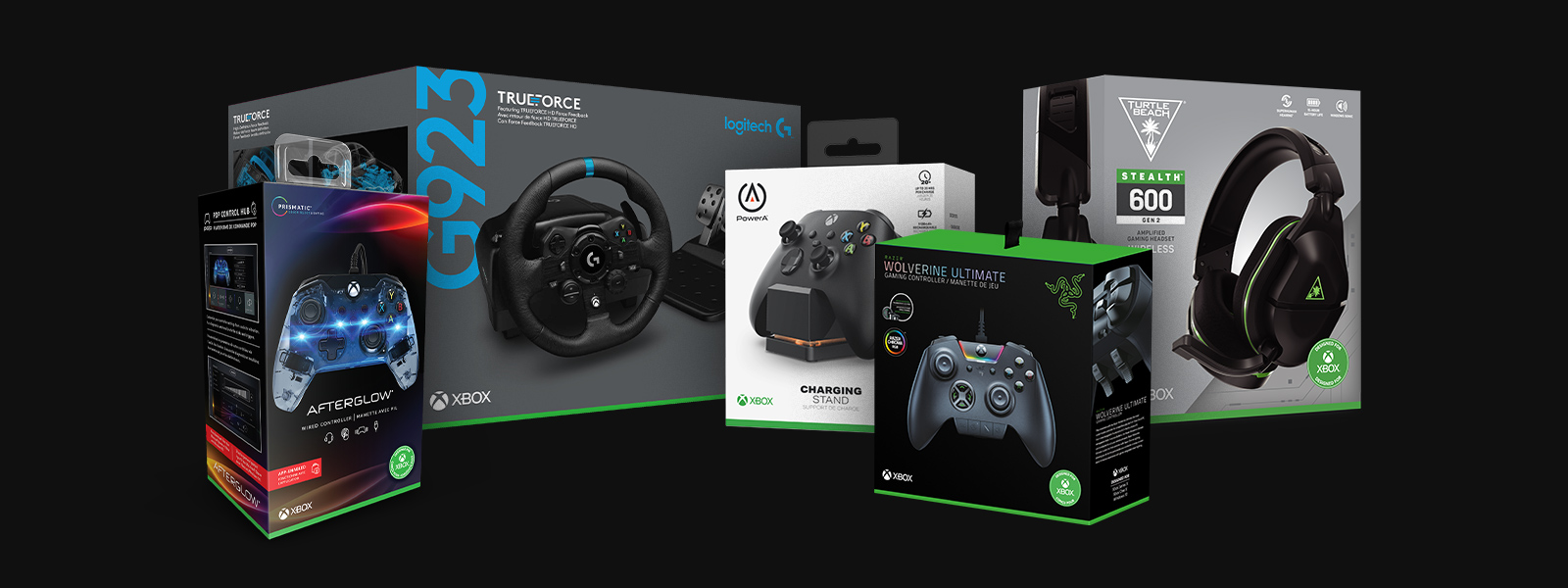 Collection of boxed Xbox accessories including Afterglow controller, Logitech G923 wheel, PowerA charging stand, Razer Wolverine Ultimate controller, and the Turtle Beach Stealth 700 headset.