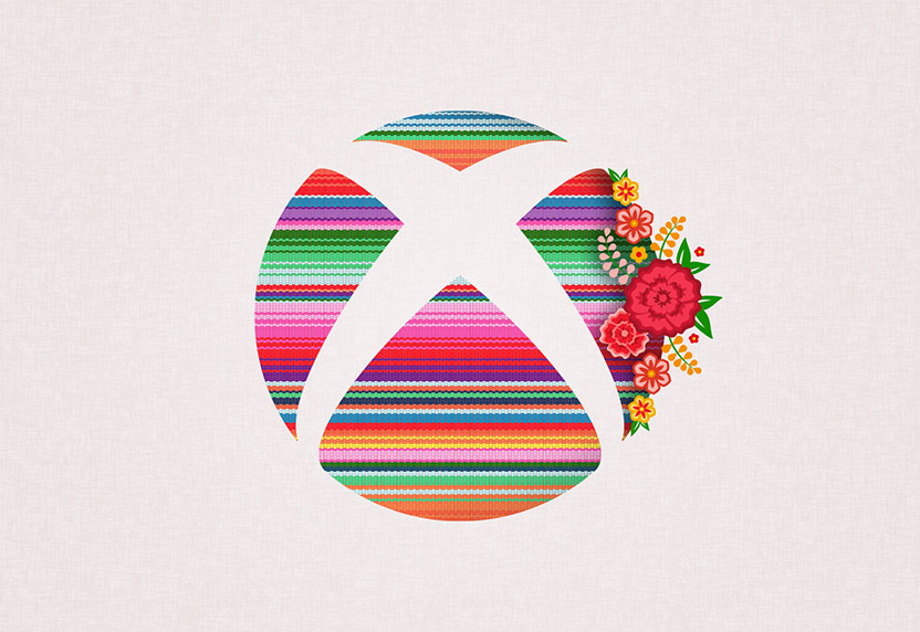 Multicolor Xbox logo with flower accents in celebration of Hispanic Heritage Month.