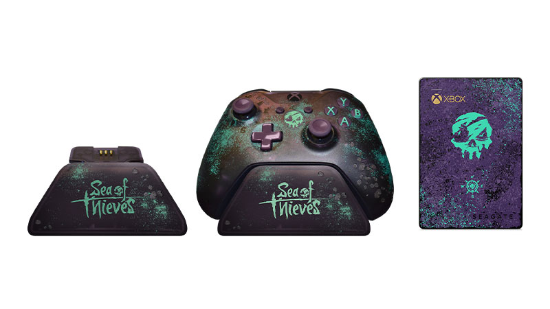 Controller stand, controller on stand and Seagate external hard drive all designed with Sea of Thieves coloring and logos.
