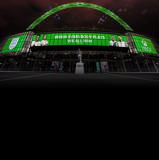 A football stadium lit up green with Xbox and The Football Association logos.