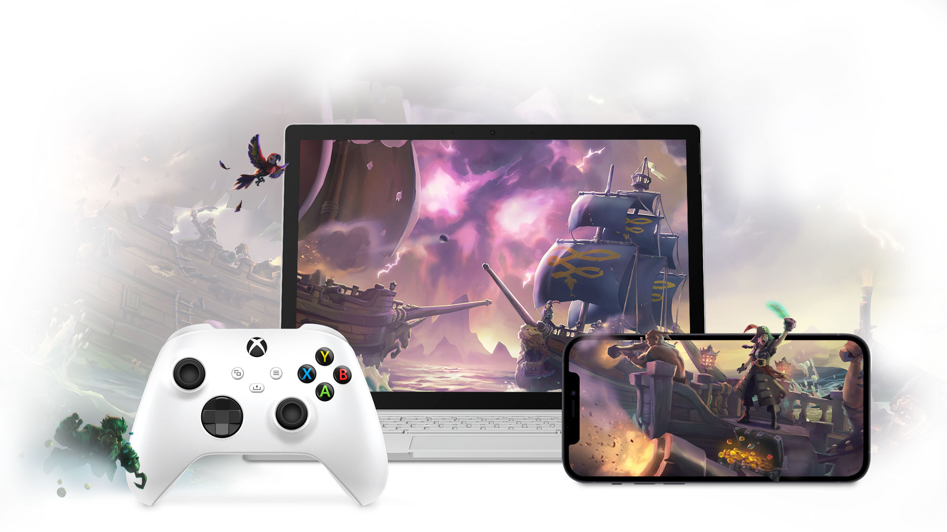 Sea of Thieves. Two pirate ships clash across the screens of a Surface Book and an Apple mobile phone. An Xbox Wireless Controller sits in front of the Surface Book.