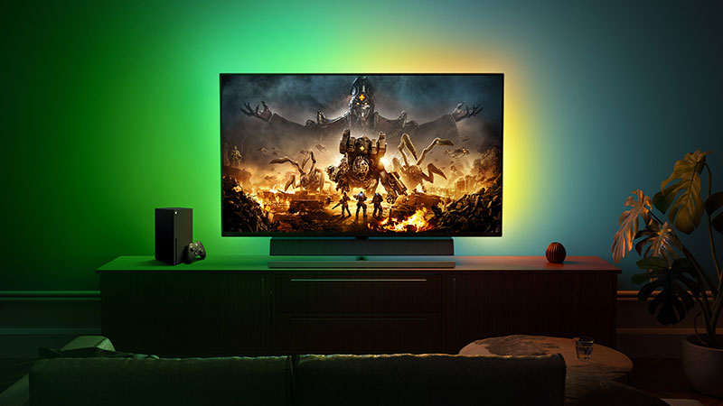 TV with custom LED backlighting playing Gears Tactics on Xbox Series X.